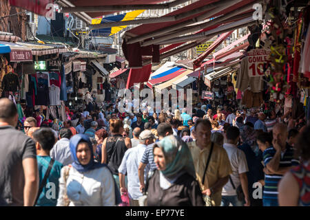 A bustling crowded shopping street near the Grand Bazaar in Istanbul filled with shoppers - Stock Photo