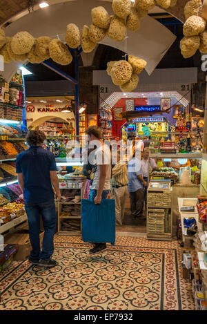 A shop within the Spice Bazaar in Istanbul selling various spices and products - Stock Photo