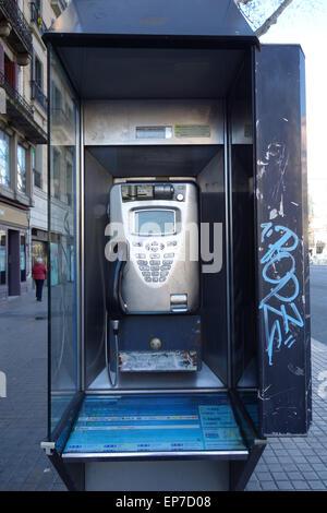 Public telephone in the street in Barcelona - Stock Photo