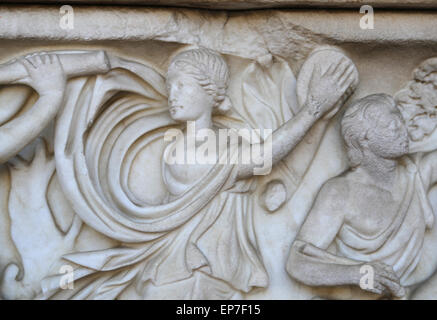Sarcophagus with Dionysiac ceremonial procession on the front and on the sides, and banquet scene with Dionysus - Stock Photo