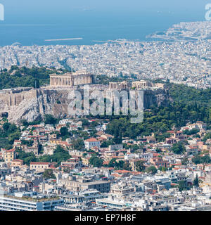 The Parthenon on the ancient Acropolis in Athens taken from the top of Mount Lycabettus looking down across the - Stock Photo