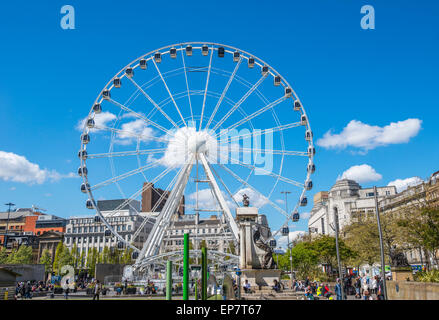 The Manchester Wheel tourist attraction in  Piccadilly Gardens, Manchester city center, England - Stock Photo