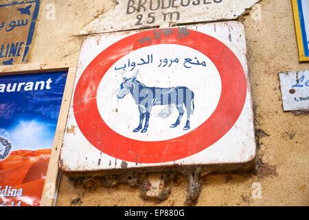 Fez. Traffic sign - No entry for donkey- on the wall at Talaa Kebira street in the Medina. Morocco - Stock Photo