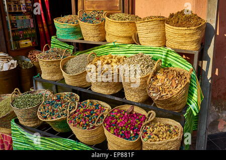 Baskets of dried flowers, rose petals, buds and herbs in the souk. Morocco - Stock Photo