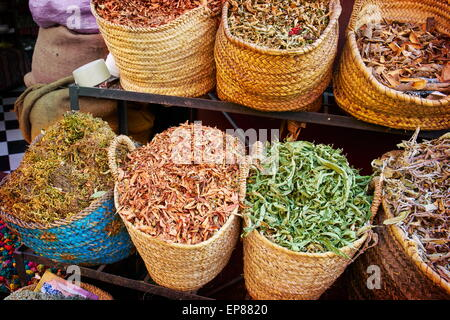 Baskets of dried spices, buds and herbs in the souk. Morocco - Stock Photo