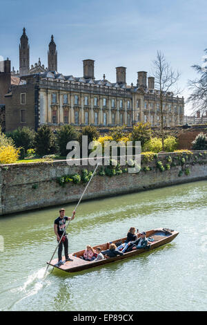 Punting on the River Cam in Cambridge England takes in the famous Backs of the University Colleges, here, Clare - Stock Photo