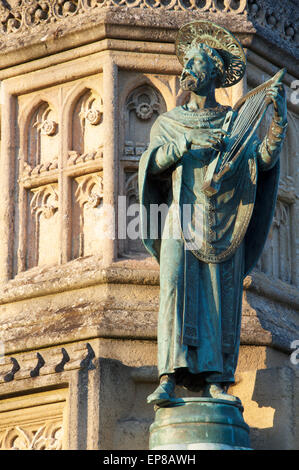 Monuments. A bronze statuette of St Aldhelm, a detail from the ornate Victorian Wingfield Digby Memorial, outside - Stock Photo