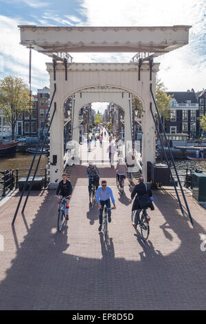 Amsterdam Magere Brug or Skinny Bridge a famous city landmark and an important link in a busy east west cross town - Stock Photo