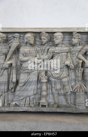Marriage ceremony. They clasp hands before a small blazing altar and the Pronuba, and the goddess Concordia. From - Stock Photo