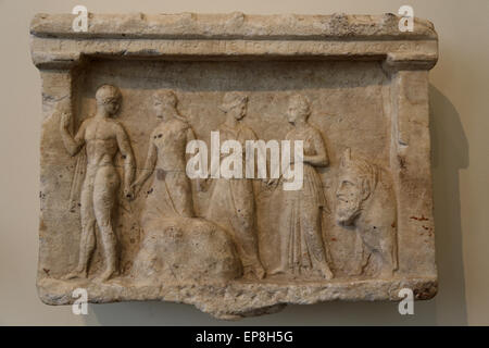 Marble relief of Hermes, three nymphs, and the river god Acheloos, who is represented in the form of a bull. Greek, - Stock Photo