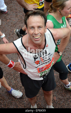 BBC News Presenter Ben Brown completes the Virgin Money London Marathon, for Cardiac Risk in the Young, of which - Stock Photo