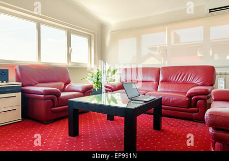 Details of a modern room, interior view, furniture in red and electric equipment for supplying electricity in between. - Stock Photo