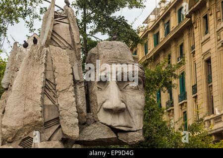1992 sculpture by  Enrique Villalobos dedicated to the Pueblo Indígena. Indigenous people,  Plaza de Armas, Chile - Stock Photo