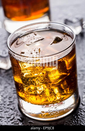 Alcoholic drink with ice in a glass - Stock Photo