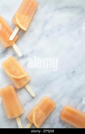 Pink Grapefruit Ice Lollies - Stock Photo