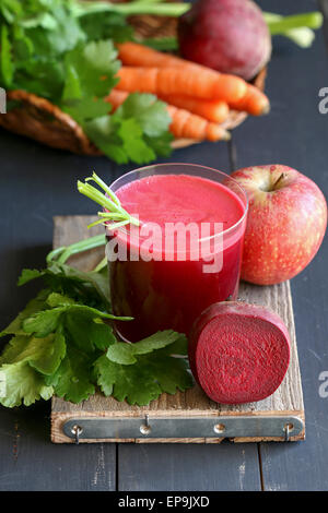 Beetroot juice with apple,carrot and celery - Stock Photo