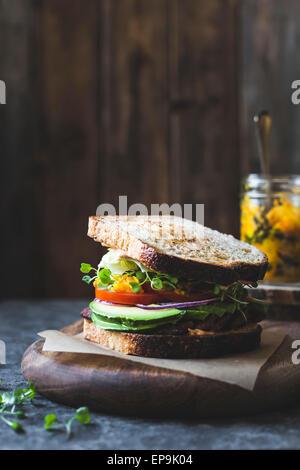 Tempah bacon, lettuce, tomato sandwich with kimchi, Avocado and Chipotle Mayonnaise - Stock Photo