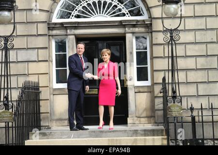 Edinburgh. 15th May, 2015. British Prime Minister David Cameron (Left) shakes hands with Scottish First Minister - Stock Photo