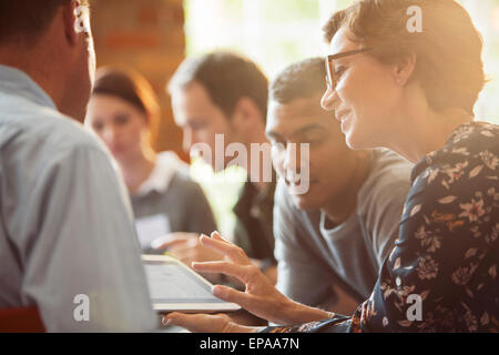 business people sharing digital tablet meeting - Stock Photo
