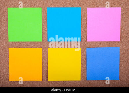 Six blank sticky notes on a noticeboard. - Stock Photo