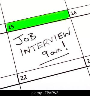 A Job Interview Date written on a Calendar. - Stock Photo