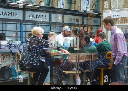 London, UK. 15th May, 2015. Jamie Oliver's Union Jacks eatery, at Covent Garden, invited 30 pupils from St Josephs - Stock Photo
