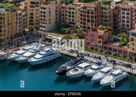 Luxury yachts moored in the Port de Fontvieille in Monaco on a sunny day - Stock Photo