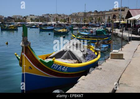 Traditional Maltese luzzu in Marsaxlokk harbour - Stock Photo