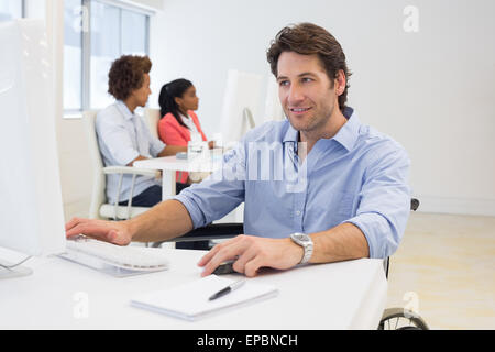 Businessman with disability works hard - Stock Photo