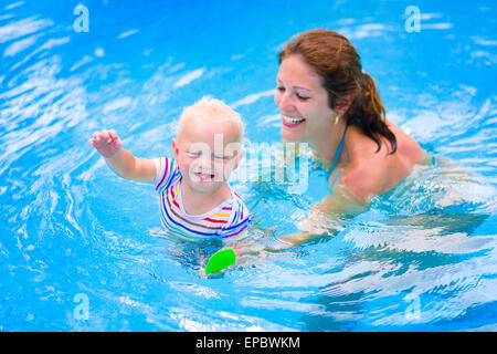A Young Boy And His Mother Floating At The Beach Of Kalives Near Stock Photo Royalty Free Image