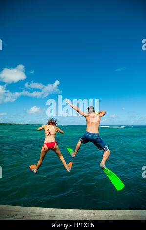 Snorkellers jumping into the waters off Uplulu Island; Upulu, Samoa - Stock Photo