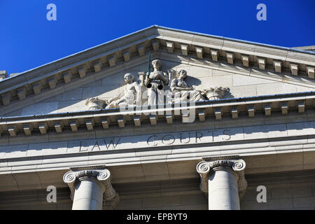 Scales of Justice carving on pediment of Law Courts Building; Winnipeg, Manitoba, Canada - Stock Photo