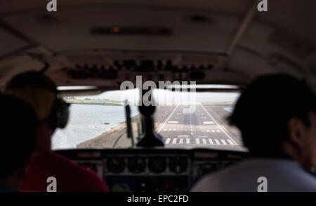 POV view through windshiled of an airplane as it is landing on the runway at Kotzebue, Arctic Alaska, Summer - Stock Photo