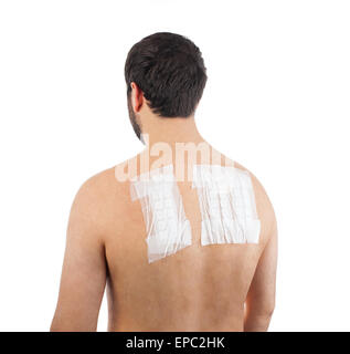 Skin Allergy Patch Test on Back of Male Patient On White Background - Stock Photo