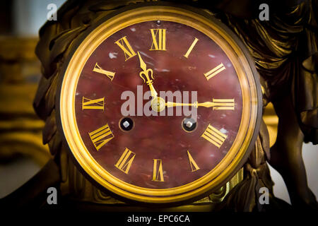detail of antique table clock with manual winding - Stock Photo