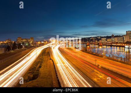 Portland Oregon Downtown Cityscape with Interstate Freeway Traffic Light Trails during Evening Blue Hour - Stock Photo