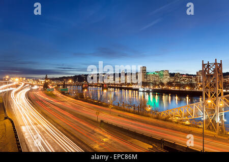 Portland Oregon Downtown Cityscape with Freeway Traffic Light Trails during Evening Blue Hour - Stock Photo