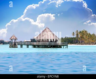 houses on piles on sea. Maldives. - Stock Photo