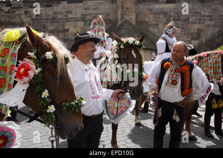 Twelve-year-old Frantisek Libosvar dressed as a girl and with a rose in his mouth leads the royal procession during - Stock Photo
