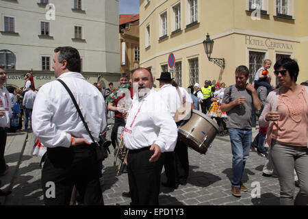 The Musicians at the Ride of Kings event in Prague, Europe - having a break. Backdrop spectators and the old architecture - Stock Photo