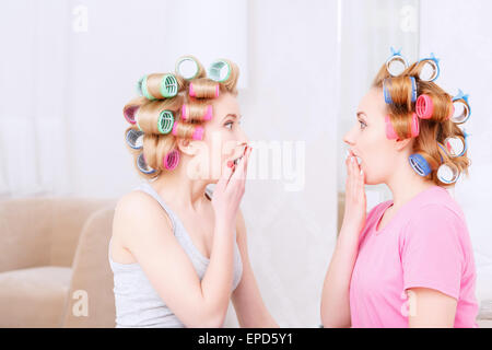Young girls sharing secrets - Stock Photo
