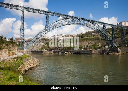 Maria Pia Bridge in Porto, Portugal, wrought iron railway arch bridge over Douro river, opened in 1877, Gustave - Stock Photo