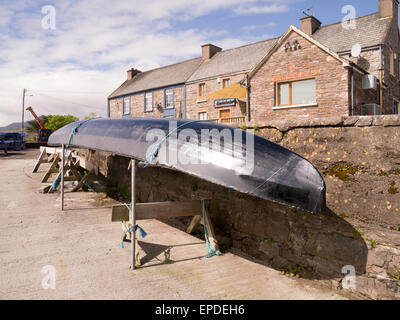 A curragh, a traditional fishing boat on Brandon Pier on the Dingle Peninsular,County Kerry on the Wild Atlantic - Stock Photo