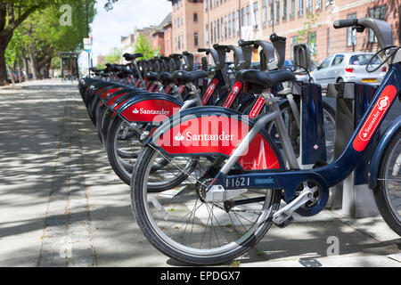 May 2015 - Barclay's logos are replaced by Santander in the London bicycle hire scheme - Stock Photo
