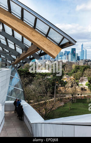 Foundation Louis Vuitton art gallery rooftop terrace in Paris.  People look at view of Paris skyline and Jardin - Stock Photo