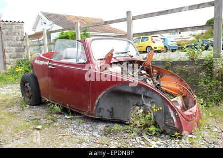Abandoned custom car project VW Volkswagen beetle rusting behind a bar in Brean Somerset, 17th May 2015 - Stock Photo