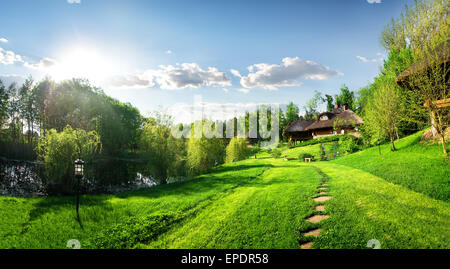 Houses of log and landscape in the morning - Stock Photo