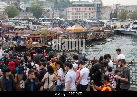Tourists, locals and fishermen on the Galata Bridge in Eminönü, Istanbul - Stock Photo