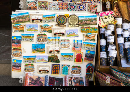 Colourful fridge magnet tourist souvenirs of Granada on display outside a souvenir shop, Granada, Andalucia, Spain - Stock Photo