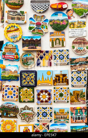 Colourful fridge magnet tourist souvenirs of Granada displayed for sale outside a souvenir shop, Andalusia, southern - Stock Photo